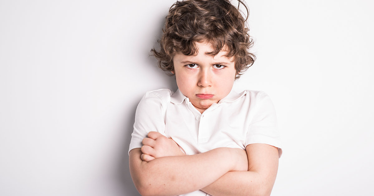 Portrait of young boy with sulk attitude