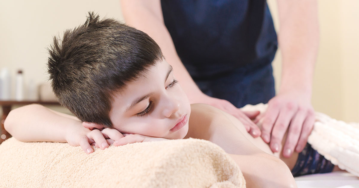 Young boy at chiropractic appointment