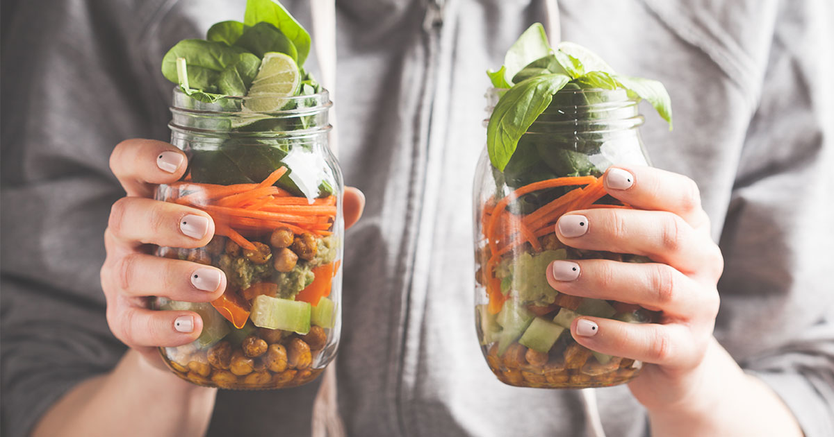 Mason jars with salad in them