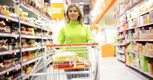 Woman pushing a shopping cart at the grocery store
