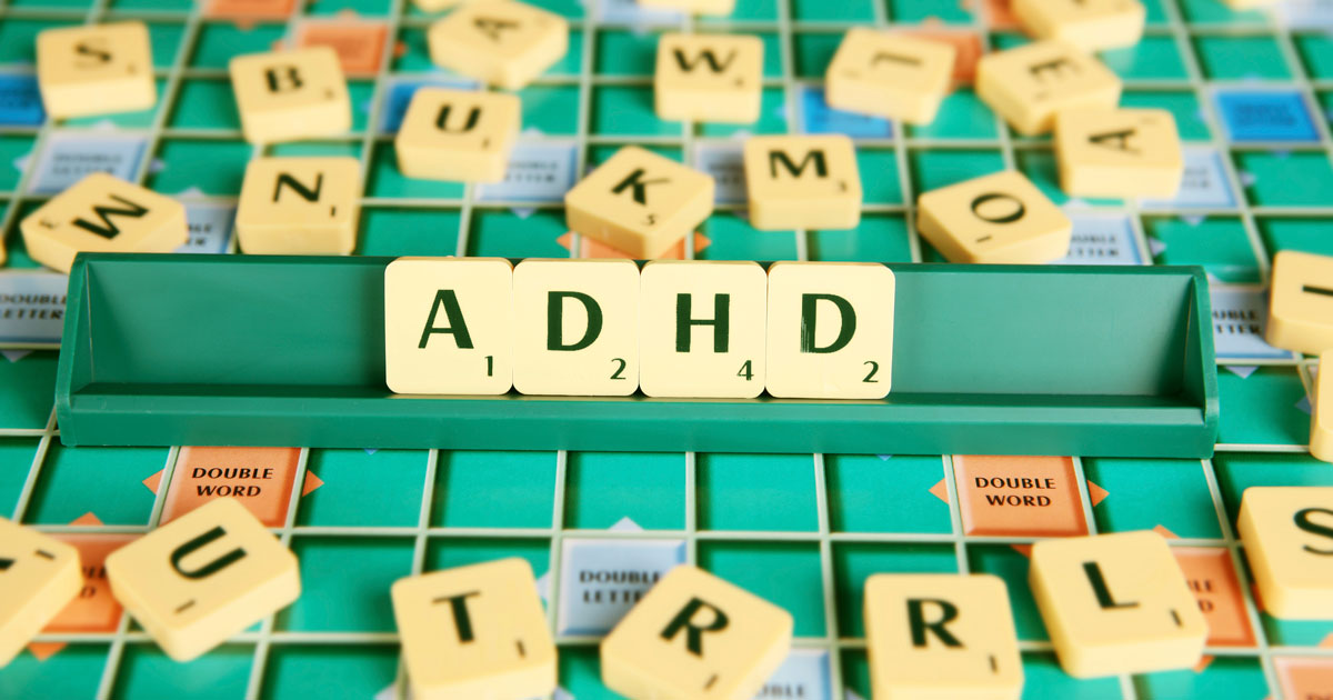 ADHD in scrabble pieces with other letters around