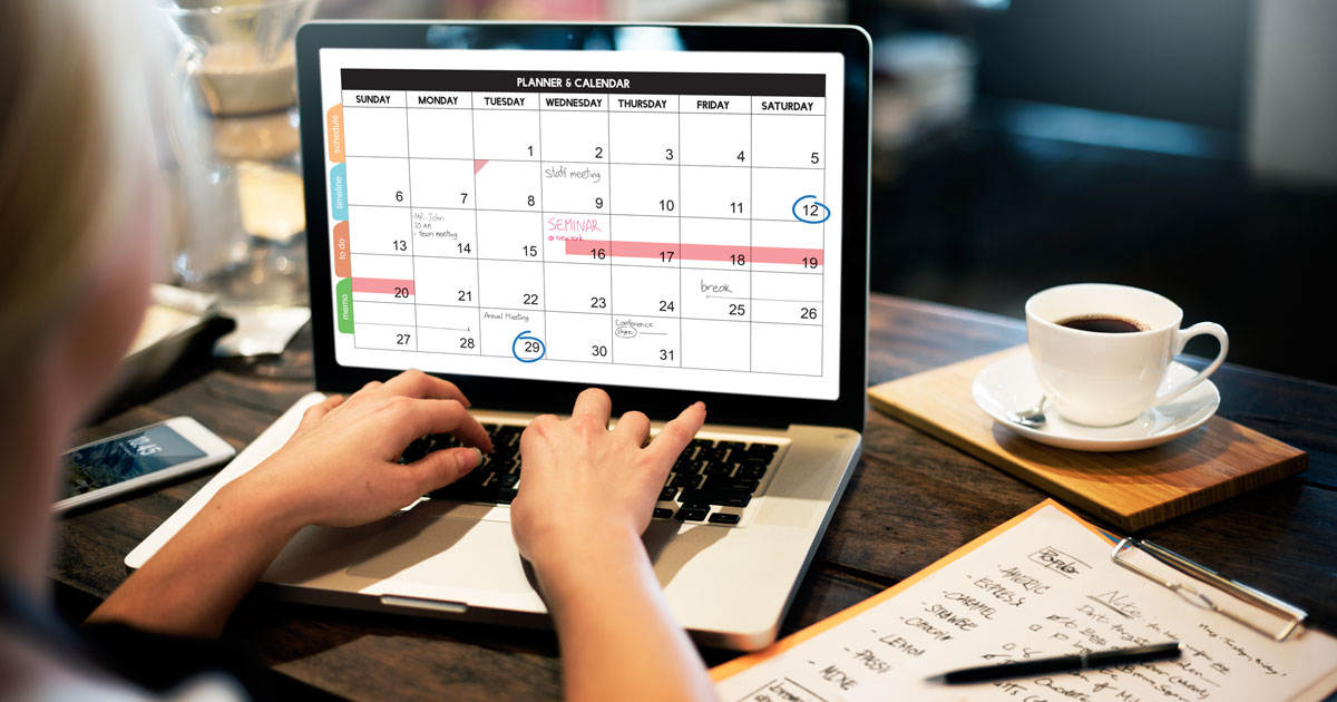 Woman working on calendar on her laptop