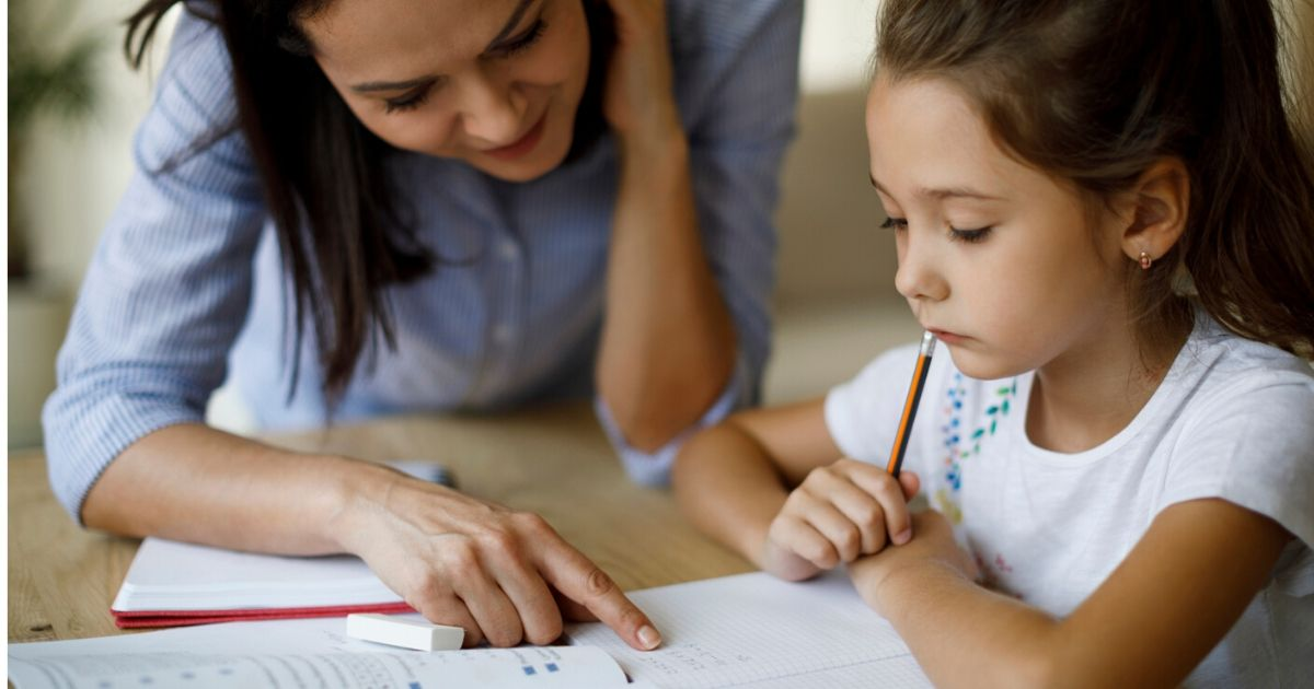 a parent working with a child who is having difficulty reading
