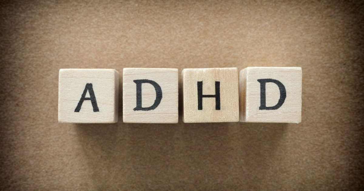 children's playing blocks spelling out ADHD